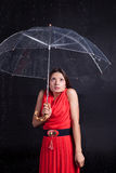 Girl in a red dress in the rain Stock Photo