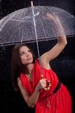 Girl in a red dress in the rain Stock Photos