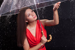 Girl in a red dress in the rain Royalty Free Stock Photography