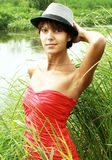 Girl in a red dress. RELAXES IN NATURE Royalty Free Stock Photo