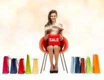 Girl in red dress with shoes, bag and sale sign Royalty Free Stock Image