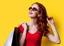 Girl in red dress with shopping bags Stock Photos