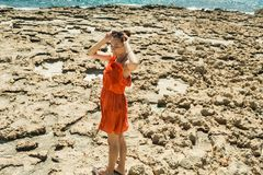 Girl in dress on the shore of the Mediterranean Sea Stock Image