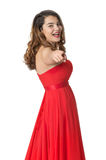 Girl in red dress shows her finger and laughing Stock Photos