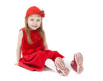 Girl in a red dress sitting on the floor Stock Images