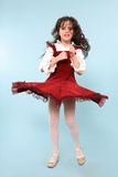 Girl in red dress spinning Stock Photo