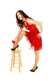 Girl in red dress standing. Stock Photos
