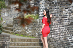 The girl in the red dress stood  on the wall of the Ming Dynasty. Chinese girl in the red dress stood  on the wall of the Ming Dynasty at Nanjing City jiansu Royalty Free Stock Photography