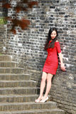 The girl in the red dress stood  on the wall of the Ming Dynasty. Chinese girl in the red dress stood  on the wall of the Ming Dynasty at Nanjing City jiansu Royalty Free Stock Image