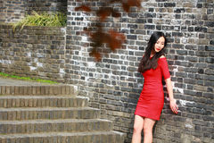 The girl in the red dress stood  on the wall of the Ming Dynasty. Chinese girl in the red dress stood  on the wall of the Ming Dynasty at Nanjing City jiansu Stock Photos