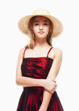 Girl in Red Dress and Stray Hat on her Head Royalty Free Stock Images