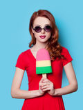 Girl in red dress with toy ice-cream Royalty Free Stock Photography