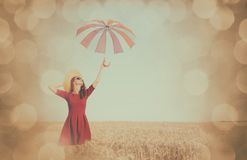 Girl in red dress with umbrella and hat Stock Image
