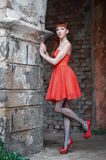 The girl in the red dress Stock Photography