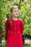 A girl in a red dress walks in the park Royalty Free Stock Photos