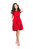Girl in red dress. Girl in a red dress on a white background in full length Stock Photo