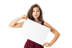 Girl in red dress with white placard Stock Photo