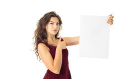 Girl in red dress with white placard Royalty Free Stock Images