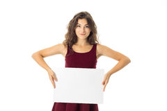 Girl in red dress with white placard Stock Photos
