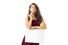 Girl in red dress with white placard Royalty Free Stock Photography