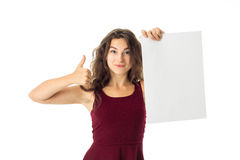 Girl in red dress with white placard Stock Images