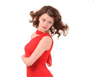 Girl in a red dress. Wind royalty free stock photography