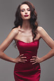 Girl in a red dress. Stock Photos