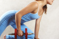 Girl and red dumbbell Royalty Free Stock Photos