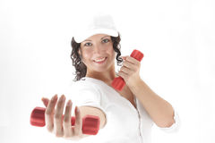 Girl with red dumbbells Royalty Free Stock Image