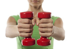 Girl with red dumbbells in hand Stock Photography