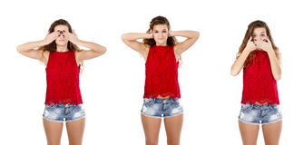 Girl in red ear speak and look no evil Royalty Free Stock Images
