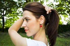 Girl with red earring Royalty Free Stock Images