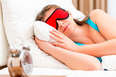 Girl with a red eye mask sleeping Royalty Free Stock Photo