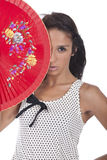 Girl with a red fan Royalty Free Stock Photo