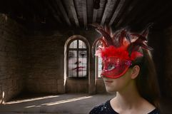 Daydreaming, masked girl in an haunted mansion stock photography