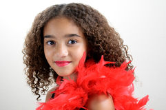 Girl with red feathers Royalty Free Stock Photo