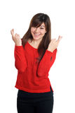 Girl in red with fingers crossed hand sign Stock Photo
