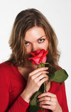 The girl in red with a flower Royalty Free Stock Photo