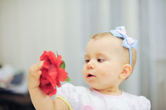 Girl with Red Flower Stock Photos