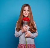 Girl with red flower Stock Photo