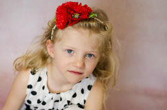 Girl with red flower in hair portrait Royalty Free Stock Images