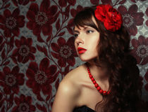 Girl with red flower in hair Royalty Free Stock Photo