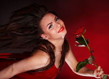 Girl with red flower rose  running. Stock Photography