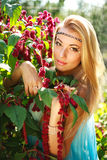 Girl in red flowers Stock Image