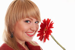 Girl in red with flowers Stock Photos