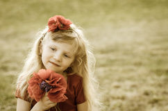 Girl with red flowers Stock Photo