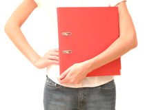 Girl with red folder in hand. A girl with office folder red color close-up Stock Photo
