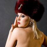 Girl in a red fur cap Royalty Free Stock Photos
