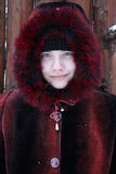 Girl in red fur coat Royalty Free Stock Photography