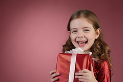 Girl with red gift box Royalty Free Stock Photo